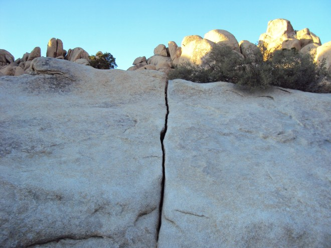 The place where two large boulders meet.