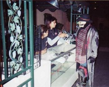 A skeleton stops to purchase a souvenir.
