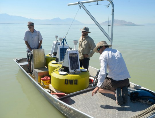 Al Hartmann | The Salt Lake Tribune Environmental scientists with Utah Division of Water Quality leave the Utah Lake Marina boat harbor with three solar buoys housing probes called sonde that should be able to give them a warning when nutrients are building up to the point that they'll have another massive algal bloom like the one in July.