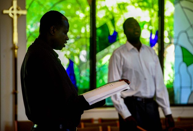 South Sudanese men sing during the Sunday worship service underway at All Saints Episcopal Church, just prior to the memorial service for Philip Aguto. Scott Sommerdorf/The Salt Lake Tribune
