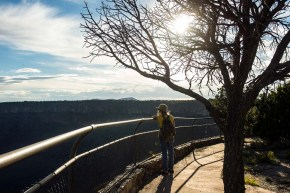 Susan Van Kollenburg, of Palatine, Illinois, looks at La Junta Overlook in Rio Grande del Norte National Monument