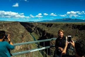Tourists on Rio Grande Gorge Bridge. The bridge is 565 feet above the Rio Grande river.