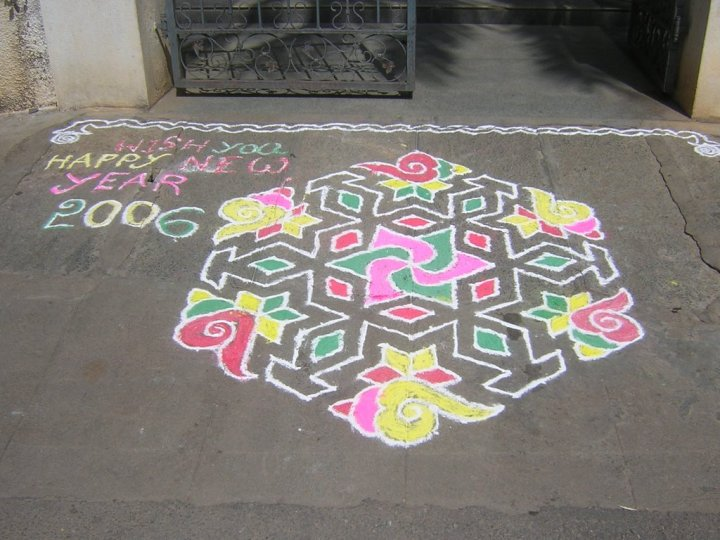Rangoli Design With New Years Wishes And Box Of Indian Sweets. 1024 x 768.Happy New Year Rangoli Designs
