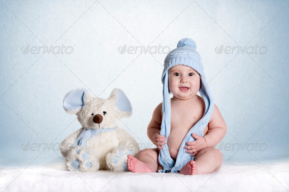 baby with a doll teddy bear