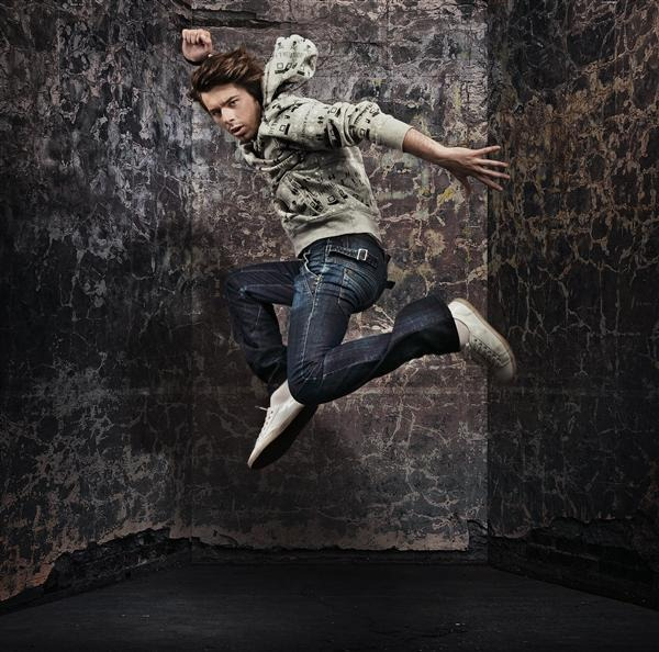 Male Dancer Over Grunge Wall