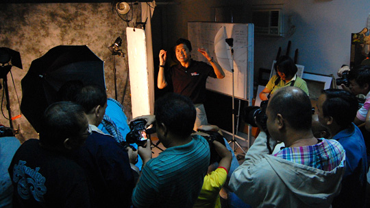 Vic Sison explains the nuances of studio lighting to a class in Advanced Photography.