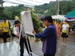 during Paiboon & Manop laying down wreath
