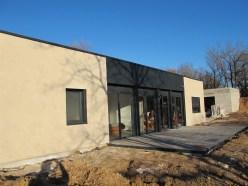 Enduit de façade sur mur à isolation répartie chaux chanvre, maison modulaire, Moduelm