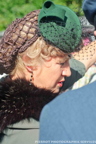 Woman in period hat at 1940s weekend in Sheringham