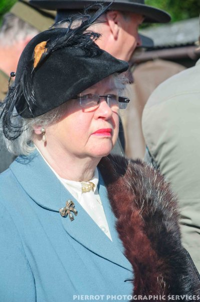 Woman in period hat and fur stole at the 1940s weekend in Sheringham