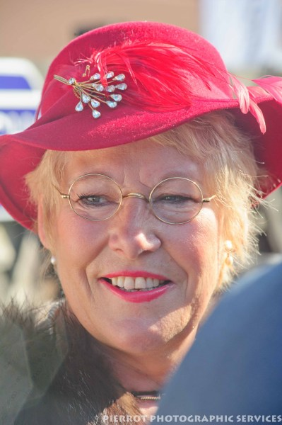 Woman in red period hat at the 1940s weekend in Sheringham 2012