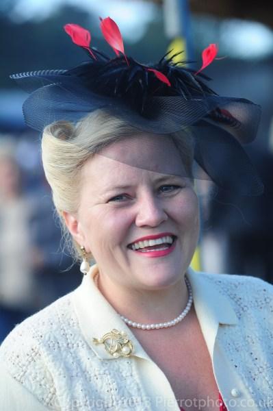 Blonde woman wearing interesting hat