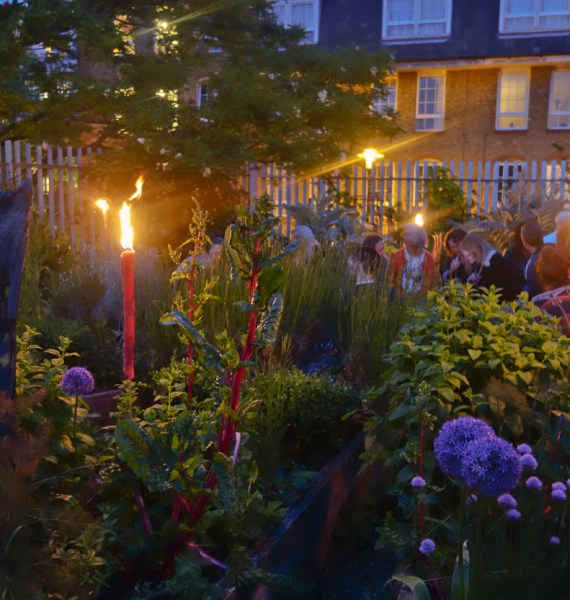 Candles lighting the garden at the Brunel Museum