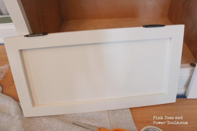 Hinges attached to cabinet door