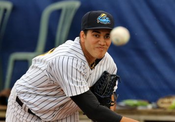 Trenton Thunder starting pitcher Ronald Herrara warms up in the bullpen before a recent start. (Photo by Martin Griff)
