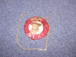 "John Wayne's picture in the center of the medallion used in Pirromount's 1988 comedy, ""Curse of the Queerwolf."""