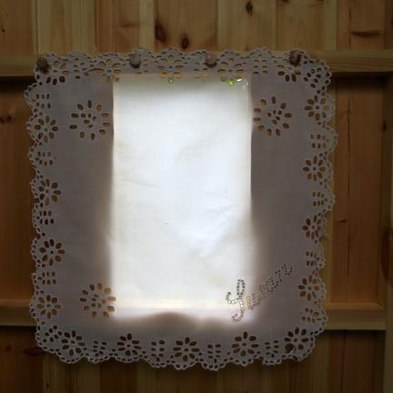 window with cutwork cloth