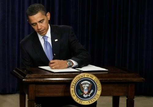 obama-signing-alone.preview