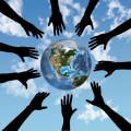 People hands reach for globe earth