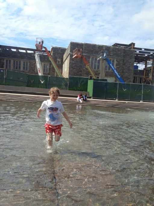 Tommy, 7, enjoys making a splash at the fountain in front of the Woodrow Wilson School at Princeton University on July 4.