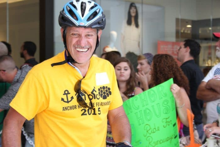 Juan Cardenosa enters the Quaker Bridge Mall at the end of the 37th annual Anchor House Ride for Runaways.