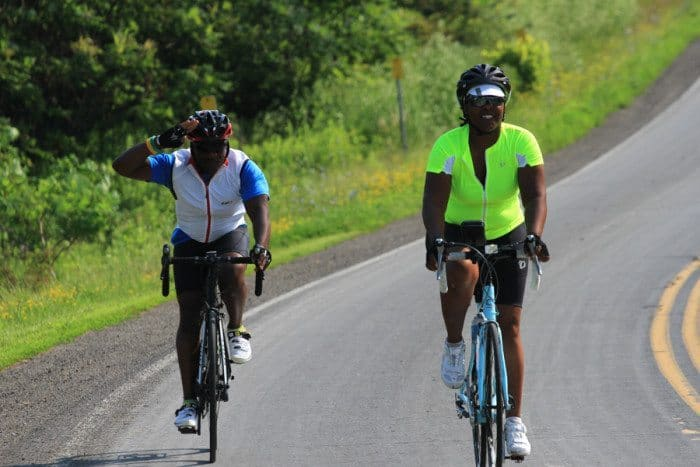 Photo caption - Kemi Alli with her husband, Dave Jacobs, on the Anchor House Ride for Runaways. Photo by Jeanne Imbrigiotta.
