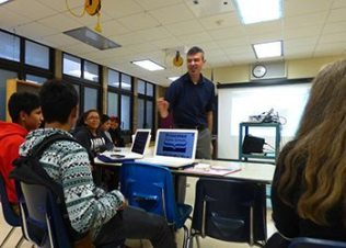 Participants in the district's new laptop lending program get tips from teacher Daniel Scibienski at a training session held at the John Witherspoon Middle School.