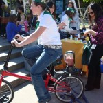 4-H demonstrates bicycle power to make a smoothie.