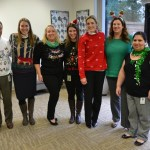 Holiday sweaters all around at Inspection Services - and antlers, and earrings...