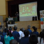 Parker Elementary students watch a presentation about where to watch out for germs in the kitchen.