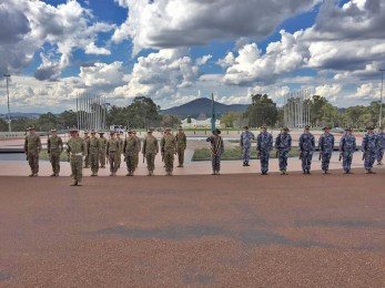 Australian troops awaiting review by the prime minister.