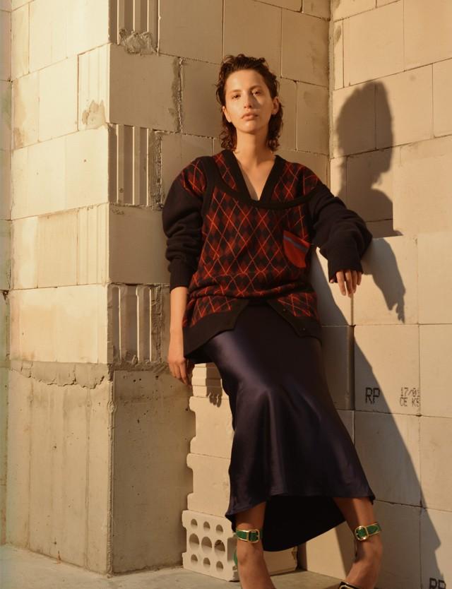 Raf wears top & cardigan – MiuMiu, dress – Acne Studios, shoes - Prada