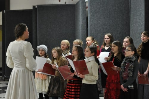 Here's Joy doing her Maria von Trapp impression as she warms up the Christmas Carolers.