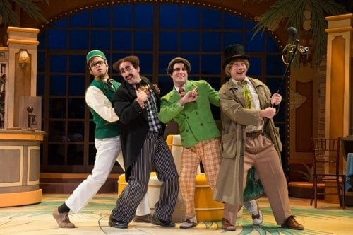 Justin Keyes (Robert Jamison), Mark Bedard (Mr. Hammer (Groucho)), John Tufts (Chico), and Brent Hinkley (Harpo) in the Guthrie Theater's production of The Cocoanuts, directed by David Ivers. Music and lyrics by Irving Berlin, book by George S. Kaufman, adapted by Mark Bedard, with musical adaptation by Gregg Coffin. Set design by Richard L. Hay, costume design by Meg Neville and lighting design by Marcus Doshi. November 14, 2015 - January 3, 2016 on the McGuire Proscenium Stage at the Guthrie Theater, Minneapolis. Photo by Jenny Graham.