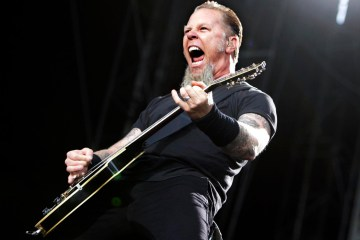 Providing lead vocals and guitar James Hetfield performs with the band Metallica, on stage during a concert at the Olympic Stadium in Stockholm, Sweden, Thursday July 12, 2007. (AP Photo Bertil Ericson/SCANPIX) ** SWEDEN OUT **