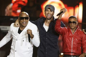 "FILE - In this April 24, 2014 file photo, Alexander Delgado, left, and Randy Malcom, right, of Cuban reggaton duo Gente de Zona, perform with singer Enrique Iglesias, during the Latin Billboard Awards, in Coral Gables, Fla. A collaboration between Iglesias and Descemer Bueno was recognized with five Latin Grammy nominations on Wednesday, Sept. 24, 2014, four of them for the megahit ""Bailando,"" also featuring Gente de Zona, and one for the song ""Loco."" (AP Photo/Lynne Sladky, File)"
