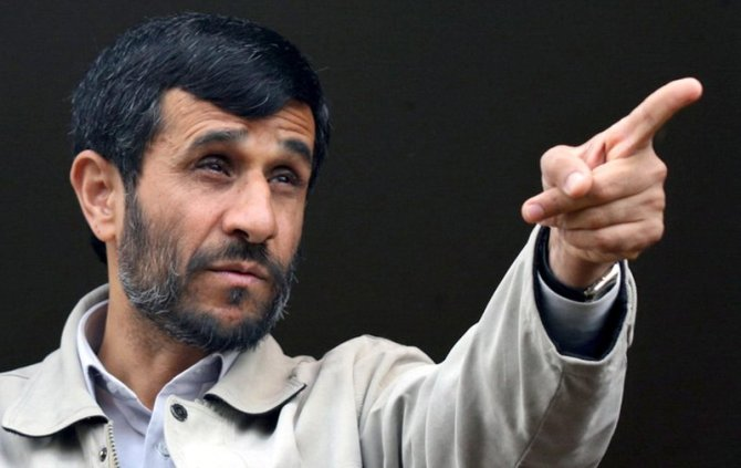 "Description=Iranian President, Mahmoud Ahmadinejad points during a public gathering in the city of Abhar about 120 miles (200 kilometers) west of the capital Tehran, Iran, Friday, April 28, 2006. Ahmadinejad vowed Thursday that no one could make Tehran give up its nuclear technology, and he warned that the United States and its European allies will regret their decision if they ""violate the rights of the Iranian nation."" (AP Photo/Mehr News, Sajjad Safari)"