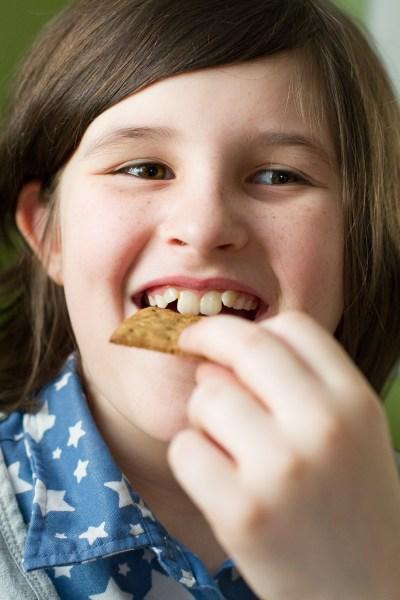 my daughter enjoying a graham cracker