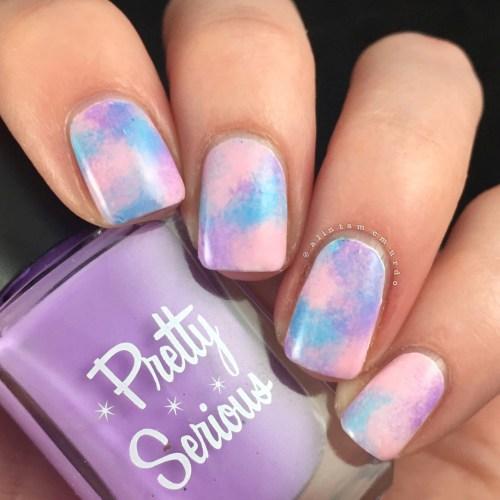 Random pastel polish sponging to create galazy nails
