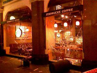 Starbucks windows smashed in London