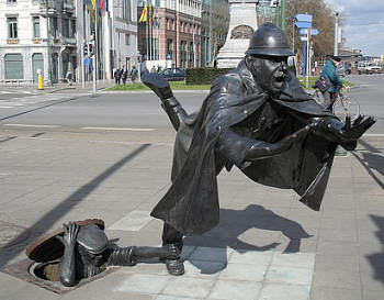 the tripping policeman statue