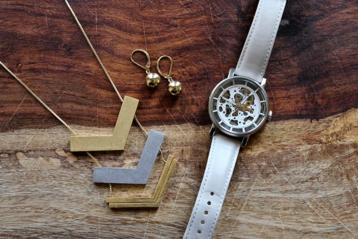 Jewelry from a winter capsule wardrobe. Madewell Floating Arrow necklace, gold earrings, and Fossil Mechanical Boyfriend watch.