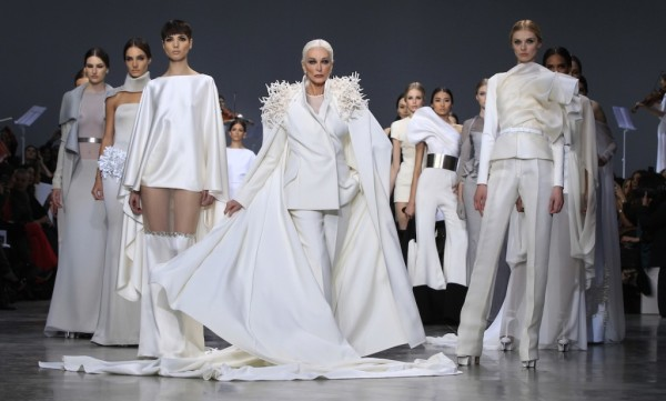 Carmen Dell'Orefice, 81, presents a creations by French designer Rolland as part of his Haute Couture Spring-Summer 2013 fashion show in Paris