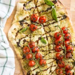 Blistered Caprese Pizza with Garlic Scape Pesto