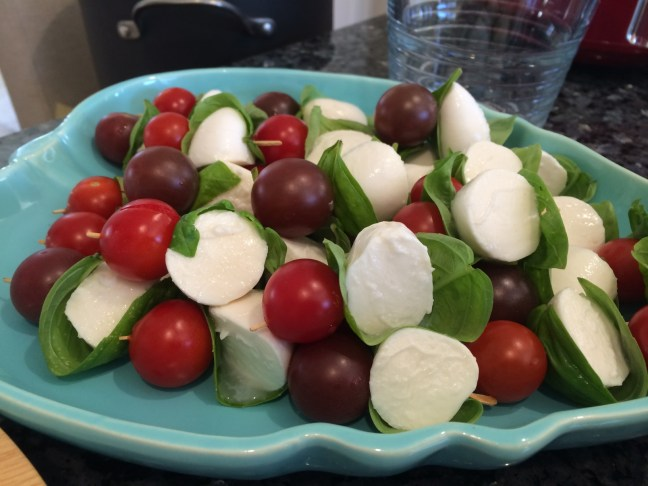 Homegrown cherry tomatoes and basil with bocconcini.