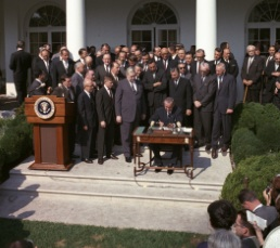 LBJ signs the EOA.