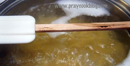 wooden spoon over boil water