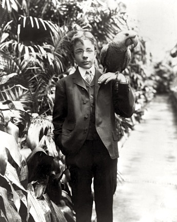 Theodore Roosevelt Jr. and Eli the Hyacinth macaw, June 17, 1902. Library of Congress photo.