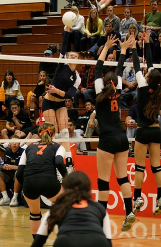 Carly Wopat gets way up for a kill.