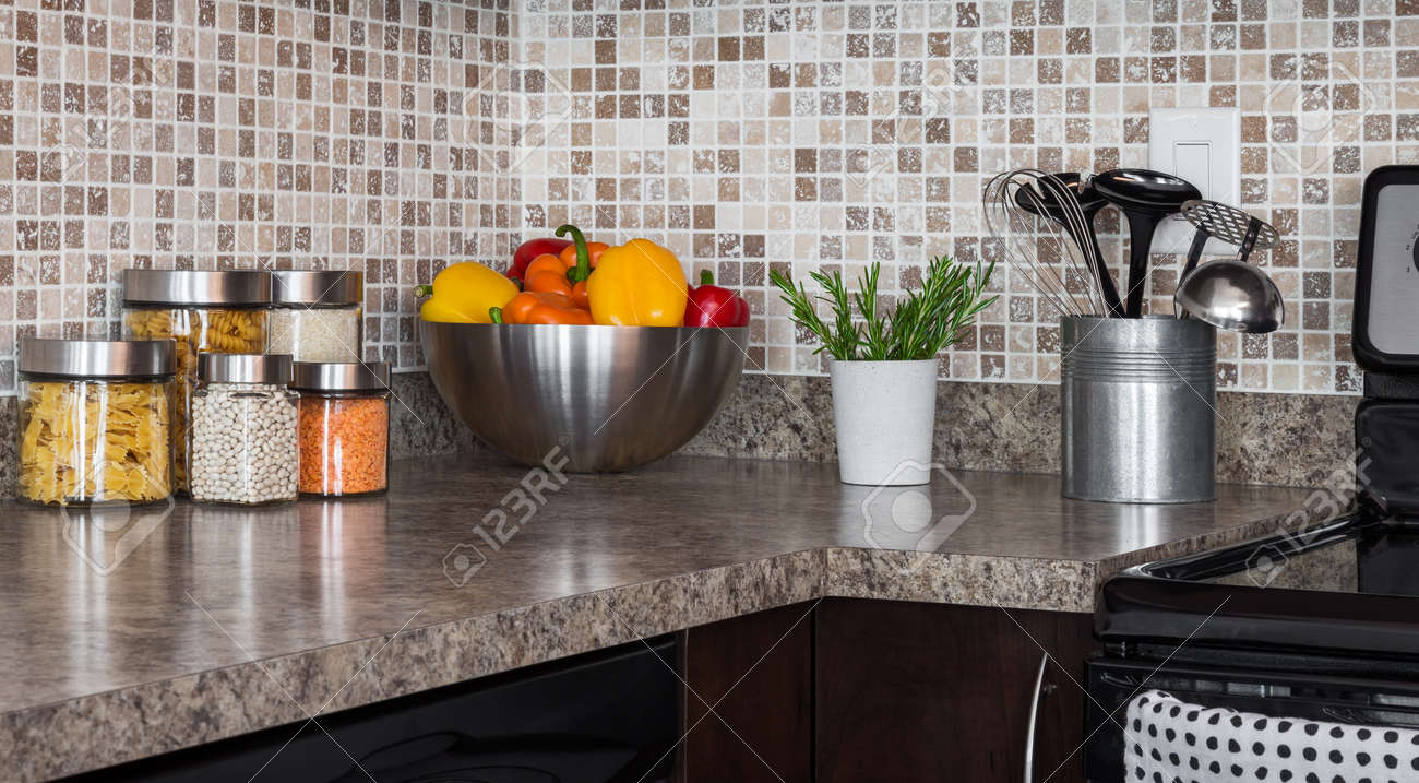 17641191 Food ingredients and green herbs on modern kitchen countertop Stock Photo